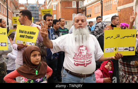 London, UK. 21st June 2019. Protest in front of the Egyptian embassy in London, in remembrance of Morsi, who recently collapsed in court in Cairo. Credit: Joe Kuis / Alamy News - Stock Photo