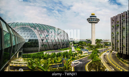Singapore - May 1,  2019: Exterior view of Jewel and Control Tower. Jewel Changi Airport is a mixed-use development at Changi Airport in Singapore, op - Stock Photo