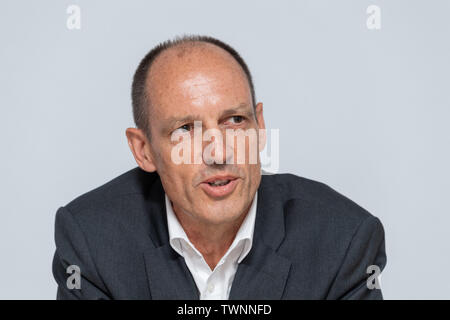 Dresden, Germany. 21st June, 2019. Jörg Michaelis, President of the Police Administration Office in Saxony, sits on the podium during the presentation of the new Messenger app, MePol app, to the police in Saxony. Credit: Robert Michael/dpa-Zentralbild/dpa/Alamy Live News - Stock Photo