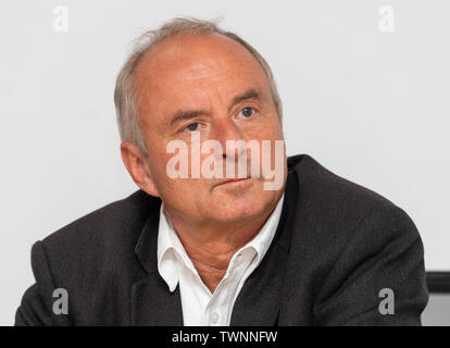 Dresden, Germany. 21st June, 2019. Matthias Klingner, head of the Fraunhofer Institute IVI, sits on the podium during the presentation of the new Messenger-App, MePol-App, to the police in Saxony. Credit: Robert Michael/dpa-Zentralbild/dpa/Alamy Live News - Stock Photo