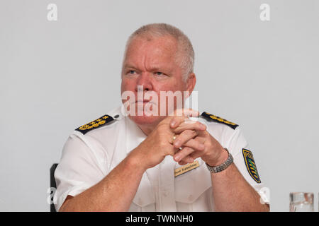 Dresden, Germany. 21st June, 2019. Horst Kretzschmar, president of the state police of Saxony, sits on the podium during the presentation of the new Messenger app, MePol app, to the police in Saxony. Credit: Robert Michael/dpa-Zentralbild/dpa/Alamy Live News - Stock Photo