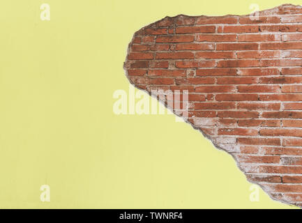 vintage old yellow crack cement wall with red brick block, antique wall for background - Stock Photo
