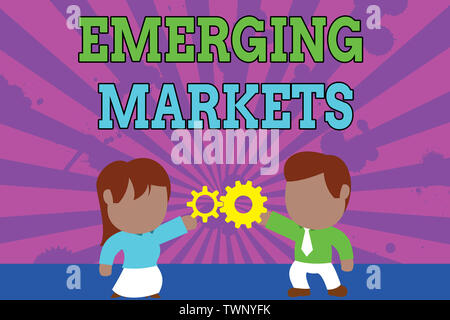 Conceptual hand writing showing Emerging Markets. Concept meaning country that has some characteristics of developed stores Young couple sharing gear - Stock Photo
