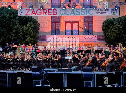 Director leading Symphony Orchestra concert, part of Zagreb Classic Open Air Festival, Zagreb Croatia, June 21, 2019 - Stock Photo