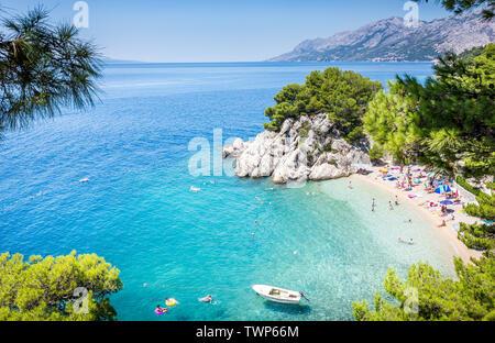 BRELA, CROATIA - JULY 20, 2018: Tourists relaxing on marvelous Brela beach, beautiful Mediterranean seascape in Croatia - Stock Photo
