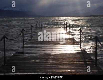 Wooden pier in Puerto Bories, Ultima Esperanza Bay, near the city of Puerto Natales in Southern Chile - Stock Photo