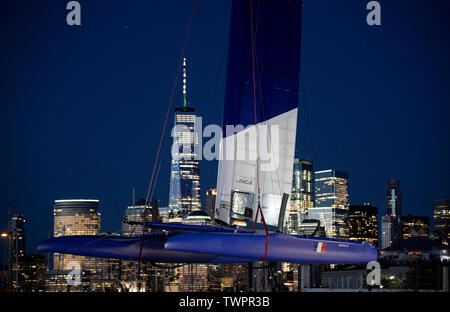 SailGP Team France crane their race yacht ashore in New Jersey following the first day of racing today. Event 3 Season 1. SailGP New York City, New York, United States. - Stock Photo