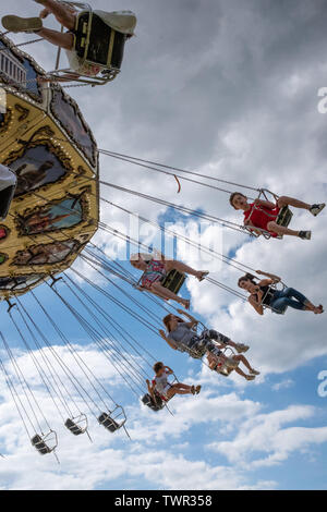 Cambridge, UK. 22nd June 2019. The Saturday of the historic annual midsummer fair with attendees on the Waveswinger ride. CamNews / Alamy Live News - Stock Photo