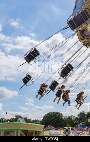 Cambridge, UK. 22nd June 2019. A child's hairband flies away whilst on the Waveswinger amusement ride at Midsummer Fair. CamNews / Alamy Live News - Stock Photo