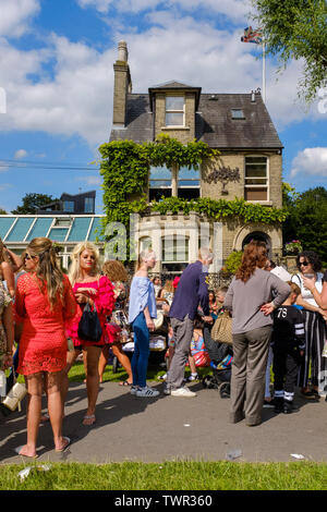 Cambridge, UK. 22nd June 2019. Attendees at Midsummer Fair fill the garden of 2 star Michelin restaurant Midsummer House. The Saturday of the historic annual midsummer fair attracts many traveller communities from around the UK. CamNews / Alamy Live News - Stock Photo