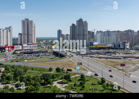 Kiev, Ukraine - May 19, 2019: view from the window of the house to the park Pozniaky and the road to Boryspil