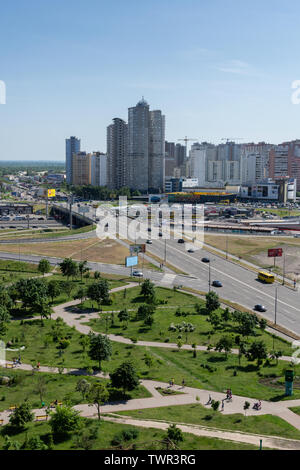 Kiev, Ukraine - May 19, 2019: view from the window of the house to the park Pozniaky and the road