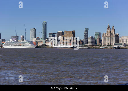 in the river Mersey at Liverpool pierhead. The Royal Liver building. - Stock Photo