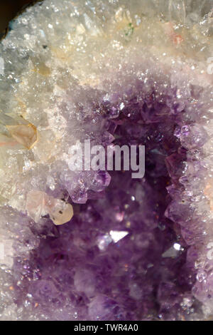 abstract amethyst quartz purple colored, amethyst geode natural crystal gemstone macro shot purple background with bokeh effect - Stock Photo