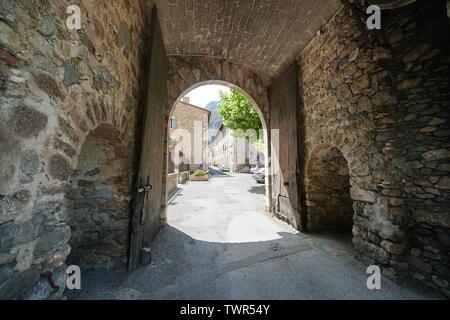 Gate entrance to medieval village Villefranche de Conflent, Pyrenees Orientales, Occitanie, France - Stock Photo
