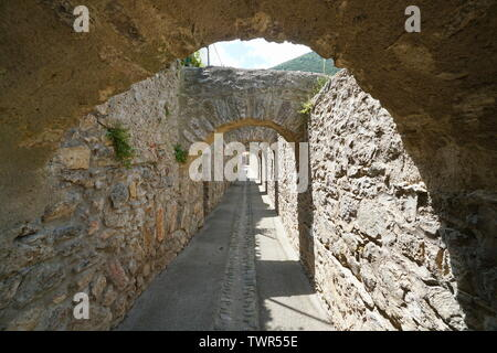 Passage under stone arches inside the fortified village of Villefranche de Conflent, Pyrenees Orientales, Occitanie, France