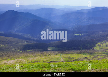 Beautiful landscape of the Carpathian mountains with sun rays - Stock Photo