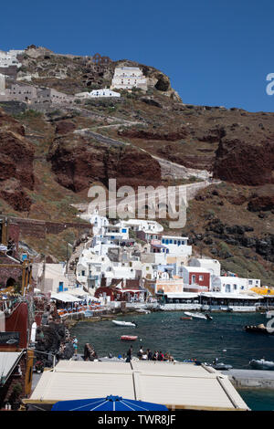 harbor town of Ammoudi Bay with the town of Oia above it on the island of Santorini, Greece - Stock Photo
