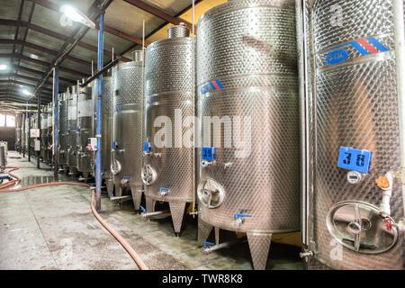 KVARELI, GEORGIA - OCTOBER 01, 2018: Fermentation tanks for wine production on the plant Kindzmarauli Corporation - Stock Photo