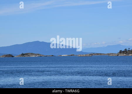 The view from the beach in Lantzville on Vancouver Island, looking across Georgia Strait to the mainland - Stock Photo