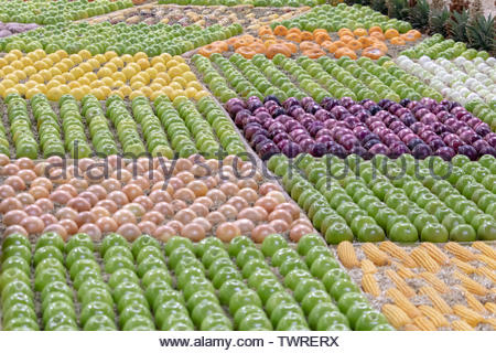 Assortment of neatly arranged fruits and vegetables on display. Fresh produce. - Stock Photo