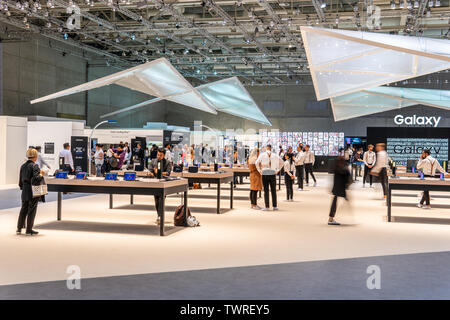 Berlin, Germany, August 30, 2018, Samsung exhibition pavilion, stand at Global Innovations Show IFA 2018, uniformly dressed customer service employees - Stock Photo