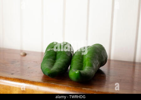 Pair of poblano peppers on a wooden table - Stock Photo