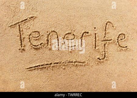 Tenerife beach word written in sand - Stock Photo
