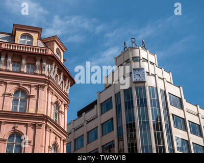 Prague, Czech Republic - June 10 2019: Classic and Modern, Old and New Architecture Meeting in Prague, Czech Republic. Modernist ARA building and its classicist neighbor. A Concept for Changes or Difference in Archtectural Style. - Stock Photo