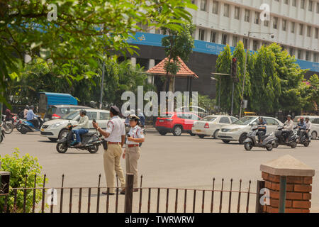 Bangalore, Karnataka India-June 04 2019 :Moving Traffic near town hall circle and City traffic police busy at work in Bengalore - Stock Photo