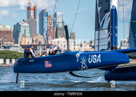 New York, USA. 22nd June, 2019. Team USA SailGP F50 catamaran sails in the Hudson river during the SailGP New York event. Credit: Enrique Shore/Alamy Live News - Stock Photo
