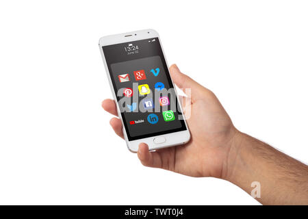 June 22, 2019. Athens, Greece. Male hand holding a smartphone with social media apps icons, isolated against white color background, close up view - Stock Photo