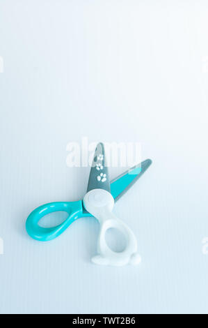 children's colourful safe scissors on a white background. scissors made of plastics to avoid injuries. - Stock Photo