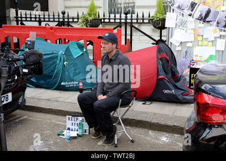 London / UK – June 22, 2019: Richard Ratcliffe (centre) conducts a TV interview at the Iranian embassy in London on day 8 of a hunger strike in support of his wife Nazanin Zaghari-Ratcliffe, jailed in Iran - Stock Photo