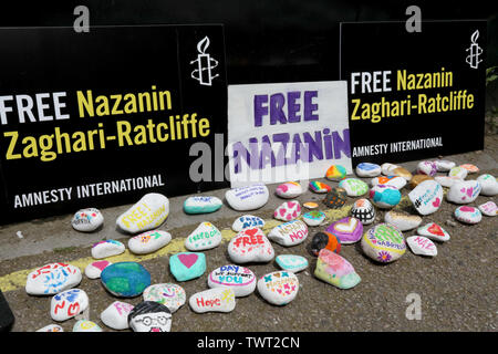 London / UK – June 22, 2019: Messages of support for Nazanin Zaghari-Ratcliffe painted on stones at the Iranian embassy in London where her husband Richard Ratcliffe is staging a hunger strike - Stock Photo