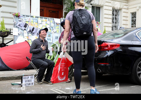 London / UK – June 22, 2019: Richard Ratcliffe (seated) talks to a supporter at the Iranian embassy in London on day 8 of a hunger strike in support of his wife Nazanin Zaghari-Ratcliffe, jailed in Iran - Stock Photo