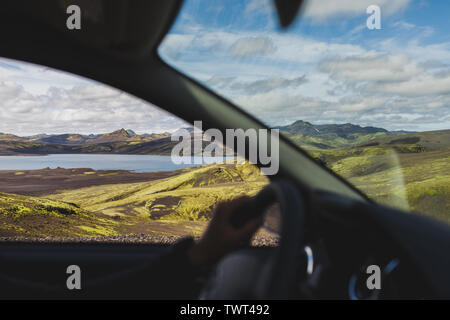 Travel to Iceland highlands by car. View of Lakagigar black volcanic desert in Iceland Skaftafell national park from car window. - Stock Photo