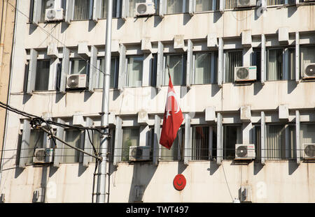 SOFIA, BULGARIA, JUNE 22, 2019: Turkish embassy in Sofia city with the traditional Turkish flag on the build in daily time. - Stock Photo