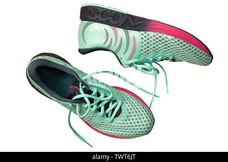 Pair of Perfect sneakers in pale blue for running isolated on white. Shoes for long races - Stock Photo
