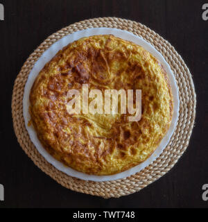 Spanish omelet, tortilla de patata, made at home - Stock Photo