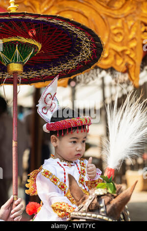 Bagan, Myanmar - March 2019: novice Buddhist monk Shinbyu initiation ceremony in a village near Bagan. Portrait of a young boy in traditional costume. - Stock Photo