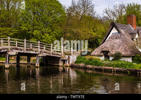 The wooden footbridge at Flatford Mill, Suffolk, UK - Stock Photo