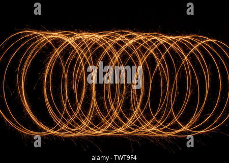 Sparkle golden glowing shiny spiral lines and circle light effect. Abstract Glowing light fire ring trace. - Stock Photo