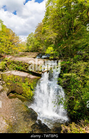 The Afon Mellte cascades over Sgwd Clun-gwyn waterfall on the Four Waterfalls Walk in the Brecon Beacons National Park, Powys, Wales, UK - Stock Photo