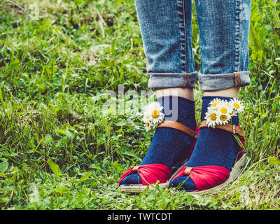 Women's legs, fashionable shoes and bright socks - Stock Photo