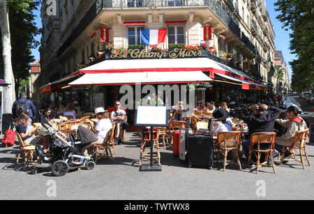 Le Champ de Mars is traditonal French cafe located near the Eiffel tower in Paris, France. - Stock Photo