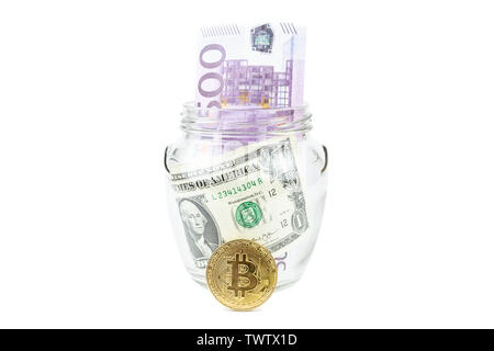 Bitcoin bronze gold coin in glass jar on white background. A set of cryptocurrencies with real dollars in the Bank. Savings, investments, financial ri