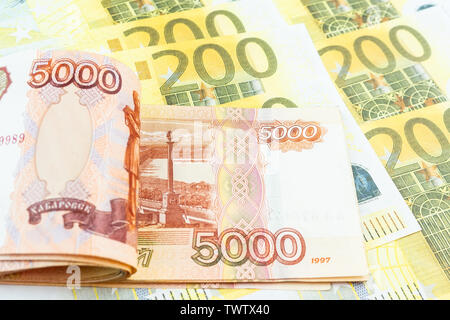 International currencies background. Money from different countries: euros, rubles. - Stock Photo
