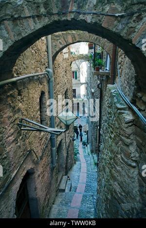 Medieval alley at the village Dolceacqua, province Imperia, Riviera di Ponente, Liguria, Italy - Stock Photo