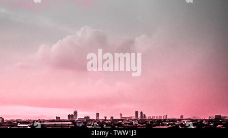 City building silhouette. Cityscape background against pink sky in evening of summer - Stock Photo